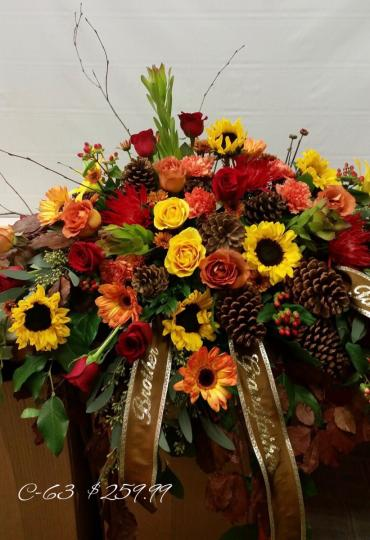 Roses Sunflowers and Pinecones Casket Spray