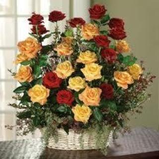 GARDEN BASKET OF RED ORANGE AND YELLOW ROSES